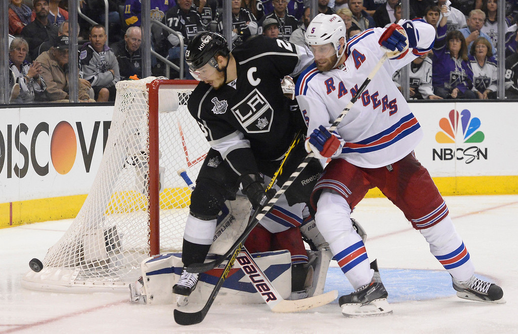 . Kings Dustin Brown gets in front of the goal with Rangers Dan Girardi on his back. The Los Angeles Kings faced the New York Rangers in game 1 of the Stanley Cup Finals. Los Angeles, CA. 6/4/2014(Photo by John McCoy / Los Angeles Daily News)