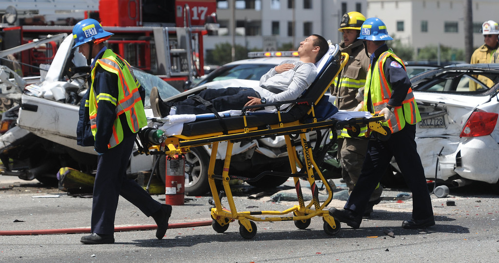 . Long Beach, Calif., -- 05-15-13-  Long Beach Police and Fire Department on the scene of a fatal hit and run accident involving four cars at the corner of Clark Ave. and Carson Street. Here paramedics transport a a person patient  to hospital.   LBPD later caught the hit and runs suspect behind the LBCC auditorium and was positively identified by a witness.     Stephen Carr/  Los Angeles Newspaper Group