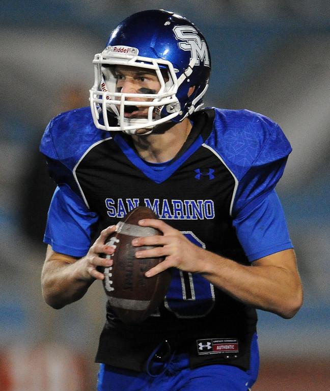 . San Marino quarterback Andrew Ferraco drops back against Monrovia in the first half of a prep football game at Monrovia High School in Monrovia, Calif., on Friday, Nov. 8, 2013.    (Keith Birmingham Pasadena Star-News)