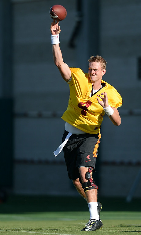 . USC quarterback Max Browne throws a pass during practice August 27, 2014 on USC\'s Howard Jones Field.(Andy Holzman/Daily News Staff Photographer)