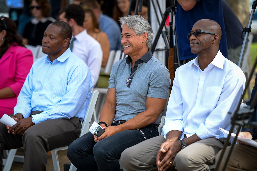 . Olympians nelson Vails, Greg Louganis and Edwin Moses at the renovation kick-off for the John Ferraro Soccer Fields at Griffith Park.  The city plans to work with the LA84 Foundation to help raise the 10 million necessary to renovate the fields and convert them to artificial turf.   ( Photo by David Crane/Los Angeles Daily News )