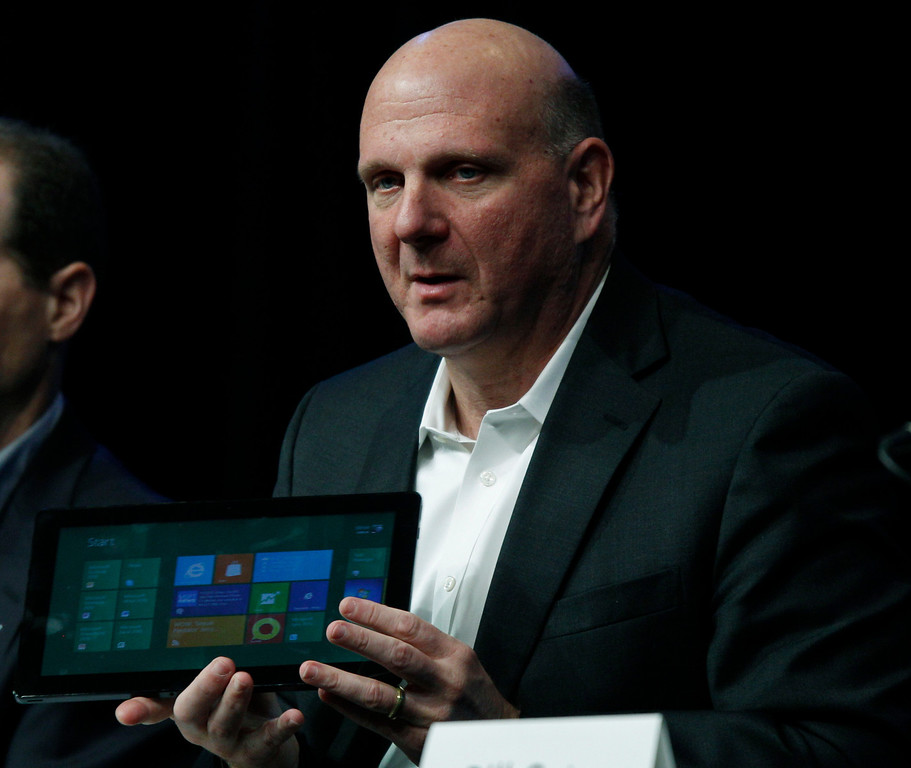 . Microsoft Corp. CEO Steve Ballmer holds a tablet computer, Tuesday, Nov. 15, 2011, at the company\'s annual shareholders meeting in Bellevue, Wash. (AP Photo/Ted S. Warren)