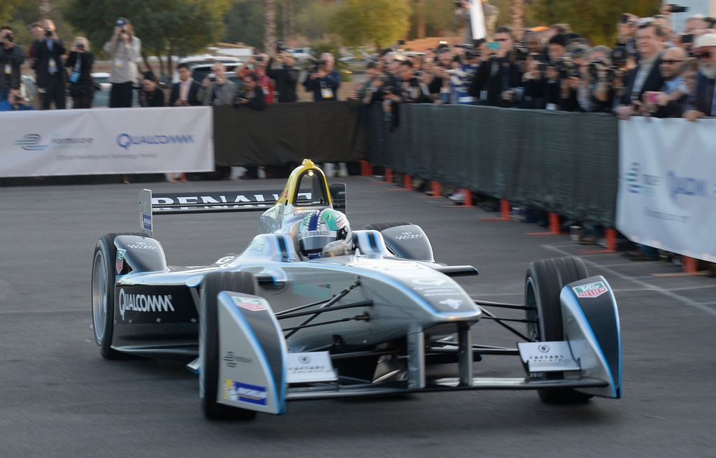 . Jan 6,2014.  Las Vegas NV. USA.  Formula  race car driver Lucas di Grassi demos the first time appearance in Las Vegas the Qualcomm FIA formula E race car,  during the 2014 CES media day show Monday. The 2014 CES show starts this Tuesday and runs till Friday with a estimated crowd of 150,000 to attend the show.. Photo by Gene Blevins/LA Dailynews