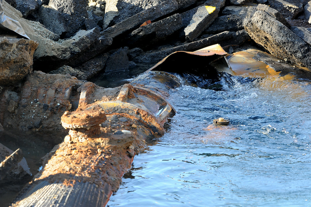 . DWP says the pipe broke at a connection of two water mains on Sunset Boulevard near UCLA, Wednesday, July 30, 2014. (Photo by Michael Owen Baker/Los Angeles Daily News)