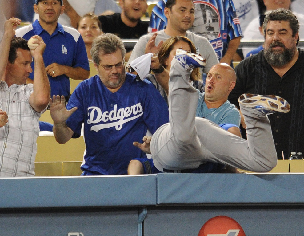. Cubs Donnie Murphy goes for a foul ball, but gets robbed by a fan. The Cubs defeated the Dodgers 3-2 in a game at Dodger Stadium. Los Angeles, CA. 8/24/2013(John McCoy/LA Daily News)
