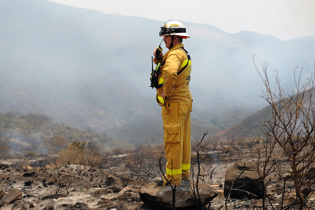 . Glendale Battalion Chief Tom Propst checks the burnt mountains off Deer Creek Road in Ventura County, Friday, May 3, 2013. (Michael Owen Baker/Los Angeles Daily News)