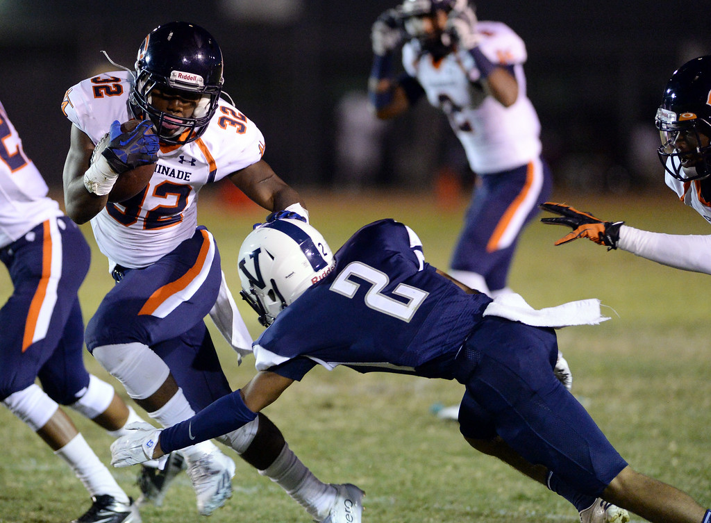 . Chaminade High School\'s T.J. Pledger #32 avoids the tackle of Venice High School\'s Dejon Jones #2 during their game at Venice High School in Venice Thursday, August 28, 2014. (Photo by Hans Gutknecht/Los Angeles Daily News)