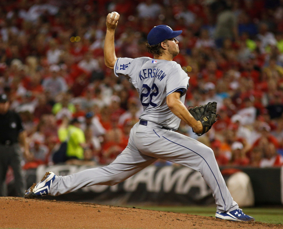 . Los Angeles Dodgers starting pitcher Clayton Kershaw throws against the Cincinnati Reds during a baseball game, Sunday, Sept. 8, 2013, in Cincinnati. (AP Photo/David Kohl)