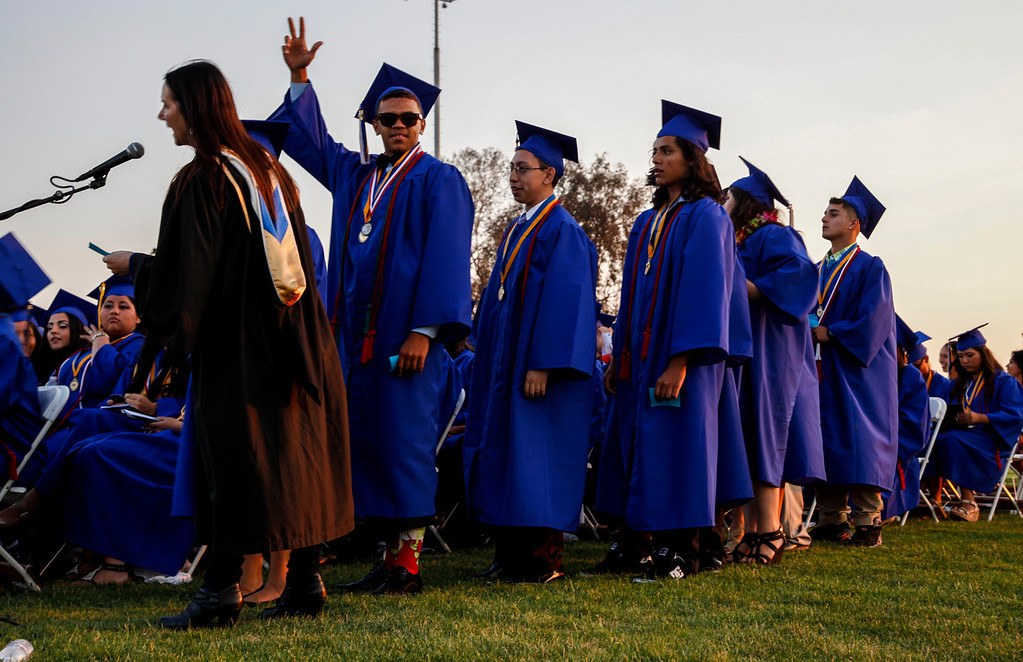 . Curtis Pike next in line to receive his diploma and become an official graduate, at John H Francis Polytechnic High School, Sun Valley, Calif., June 7, 2013. Photo: Lynn Levitt.