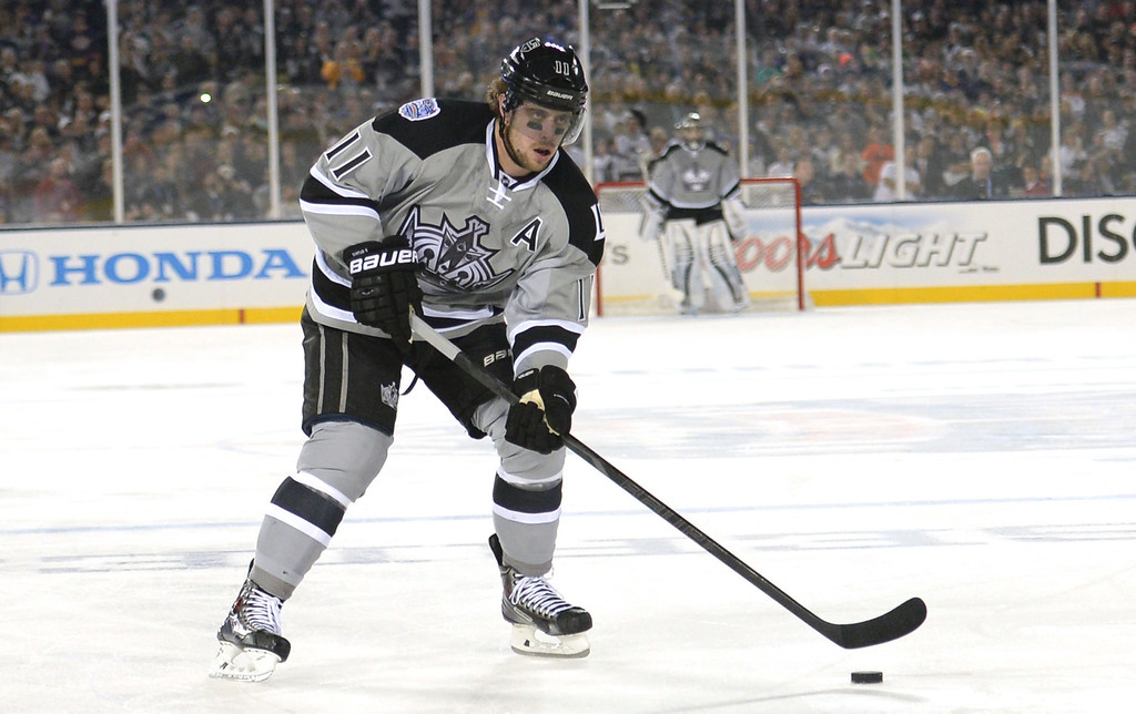 . Los Angeles Kings center Anze Kopitar controls the puck against the Anaheim Ducks in the first period of the inaugural NHL Stadium Series game at Dodger Stadium in Los Angeles on Saturday, Jan. 25, 2014. (Keith Birmingham Pasadena Star-News)
