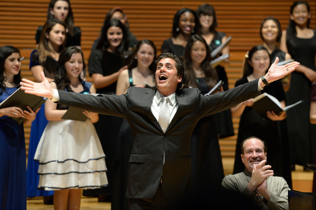 . Francisco Nunez exhausts after the honor choir sang his arrangement. 1,000 students from 28 southland High Schools performed in the Los Angeles Master Chorale High School Choir Festival at the Walt Disney Concert Hall. Directed by Grant Gershon, the choir filled the hall with music from every angle. Los Angeles, CA. 5/2/2014(Photo by John McCoy / Los Angeles Daily News)