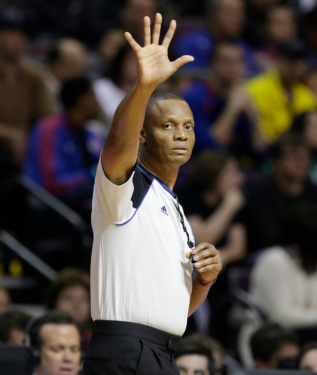 . Referee Michael Smith (38) signals during the second half of an NBA basketball game between the Detroit Pistons and the Los Angeles Lakers at the Palace in Auburn Hills, Mich., Friday, Nov. 29, 2013. (AP Photo/Carlos Osorio)