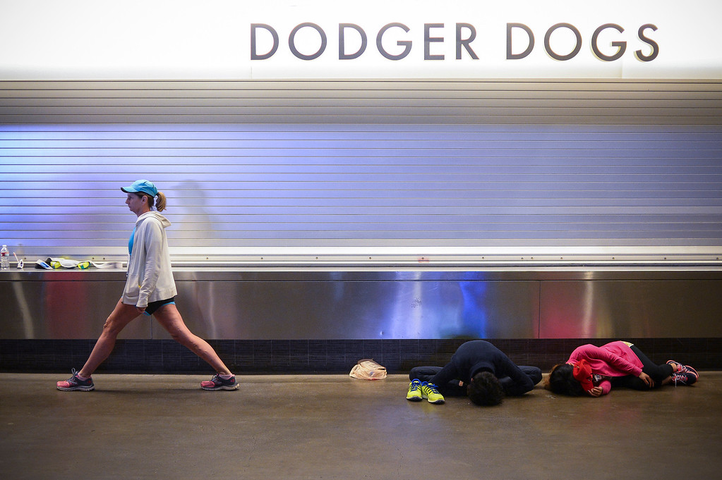 . Runners stretch and sleep at Dodger Stadium before the start of the 29th Los Angeles Marathon Sunday, March 9, 2014.   (Photo by David Crane/Los Angeles Daily News.)