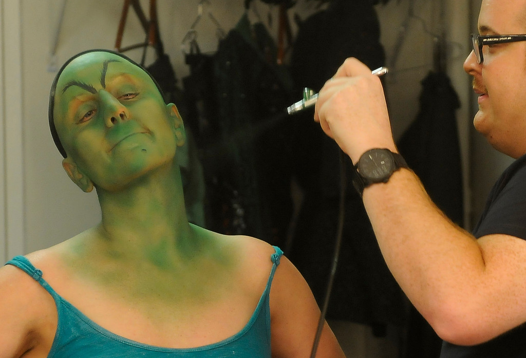 . Green makeup goes on quickly with the airbrush. Jacquelyn Piro Donovan is transformed into the Wicked Witch by makeup artist Michael King. The Wizard of Oz is being staged at the Pantages Theatre in Hollywood, CA. 9/25/2013. photo by (John McCoy/Los Angeles Daily News)