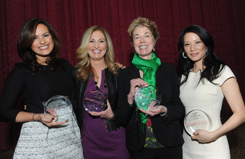 . Actress Mariska Hargitay, left, WE tv President and General Manager Kim Martin, second left,  documentary filmmaker Lisa F. Jackson, second right, and actress Lucy Liu pose together after being honored at the 32nd annual Muse Awards presented by New York Women in Film & Television (NYWIFT), Thursday, Dec. 13, 2012, in New York.   (Diane Bondareff/Invision for NYWIFT/AP Images)