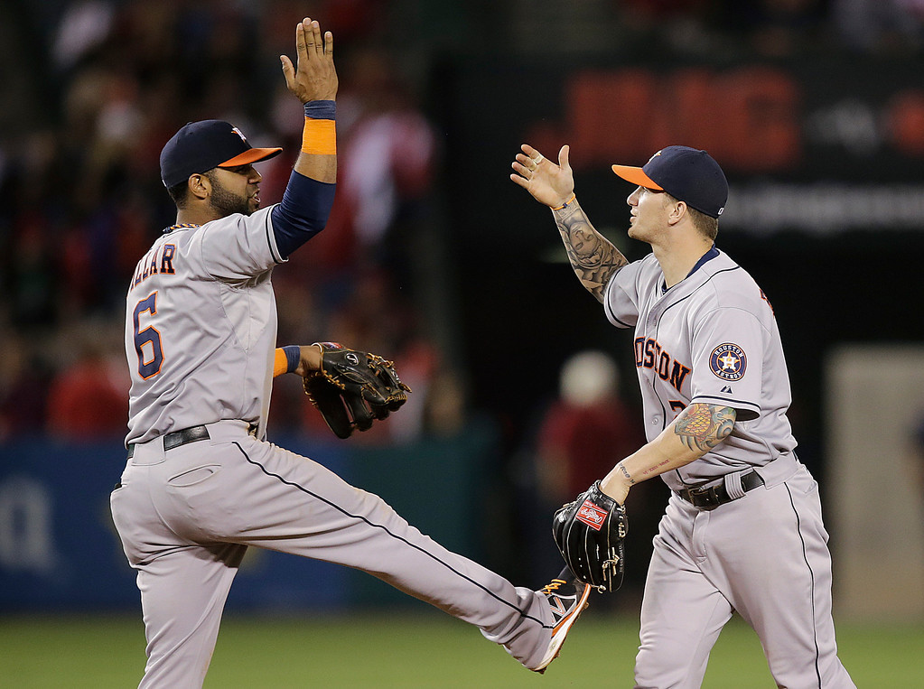 . Houston Astros\' Jonathan Villar, left, and Brandon Barnes celebrate their team\'s 8-2 win against the Los Angeles Angels after a baseball game on Friday, Aug. 16, 2013, in Anaheim, Calif. (AP Photo/Jae C. Hong)