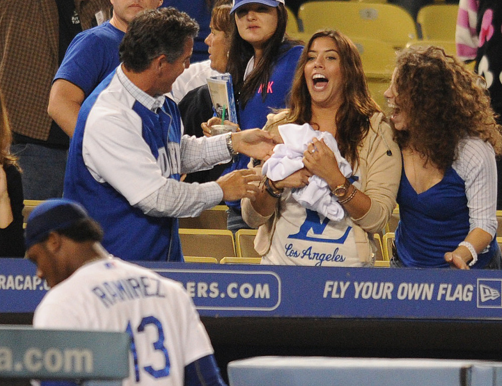 . A lucky fan clutches the jersey that was torn off the back of Scott Van Slyke and thrown into the stands after Van Slyke hit a 2 run walk off homer in the 11 inning at Dodger Stadium in Los Angeles, CA. 9/10/2013. photo by (John McCoy/Los Angeles Daily News)
