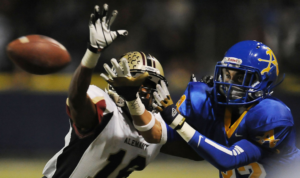 . Alemany\'s Dominic Davis (16) knocks away a pass intended for Bishop Amat\'s Brandon Arconado (82) in the first half of a prep football game at Bishop Amat High School in La Puente, Calif., on Friday, Oct. 25, 2013.    (Keith Birmingham Pasadena Star-News)