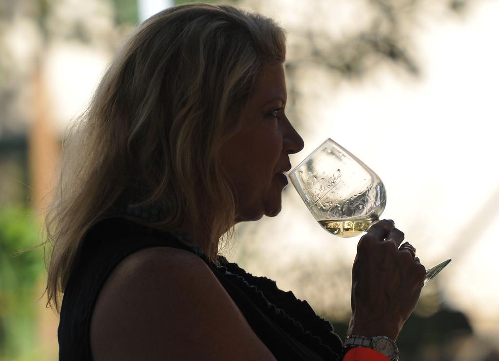 . (John Valenzuela/ Staff Photographer) Leslie Womack of Redlands enjoys a glass of wine during the Redlands Wine, Beer, and Music event at Ed Hales Park in downtown Redlands, Saturday, June 22, 2013.