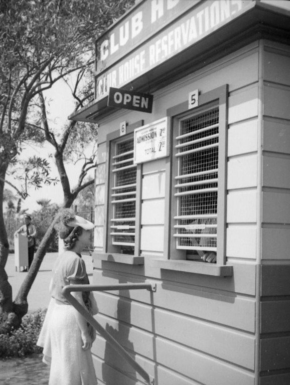 . Buying admission to the clubhouse at Hollywood Park in 1938.   (Los Angeles Public Library)
