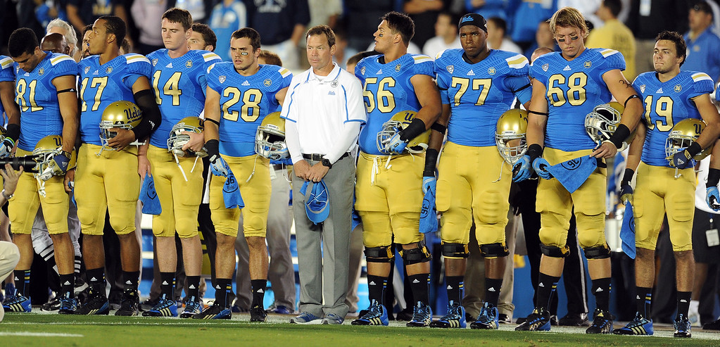 . UCLA athletes along with head coach Jim Mora during a moment of silence in honor of Nick Pasquale, the UCLA receiver who was struck and killed by a car earlier this month prior to their college football game against New Mexico State in the Rose Bowl in Pasadena, Calif., on Saturday, Sept. 21, 2013.   (Keith Birmingham Pasadena Star-News)