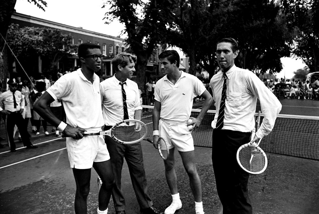 . Senator Robert F. Kennedy was paired with top-ranked Arthur Ashe, left, in an exhibition doubles tennis match at a block party near Lincoln Park in northeast Washington, August 3, 1967.  Kennedy and Ashe were opposed by #2 ranked player, Charles Pasarell, third from left, and former Davis Cupper Donald Dell.  The affair was sponsored by the D.C. Recreation Department.  (AP Photo/Bob Schutz)