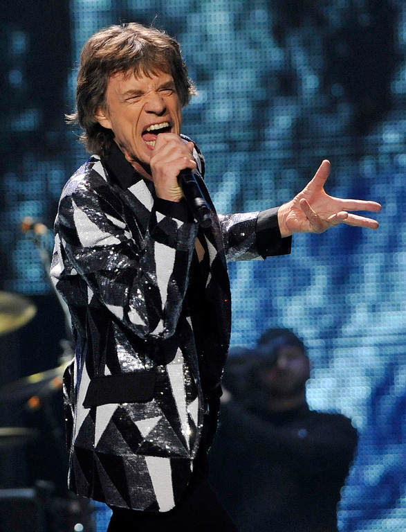 ". Mick Jagger of the Rolling Stones performs on the kick-off of the band\'s ""50 and Counting\"" tour at the Staples Center on Friday, May 3, 2013 in Los Angeles. (Photo by Chris Pizzello/Invision/AP)"