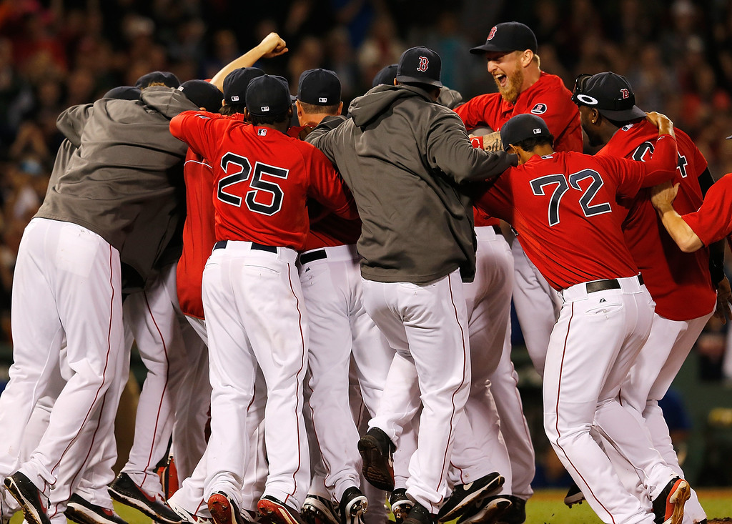 . BOSTON, MA - SEPTEMBER 20: The Boston Red Sox celebrates after winning the AL East Championship by beating  the Toronto Blue Jays at Fenway Park on September 20, 2013 in Boston, Massachusetts.  (Photo by Jim Rogash/Getty Images)