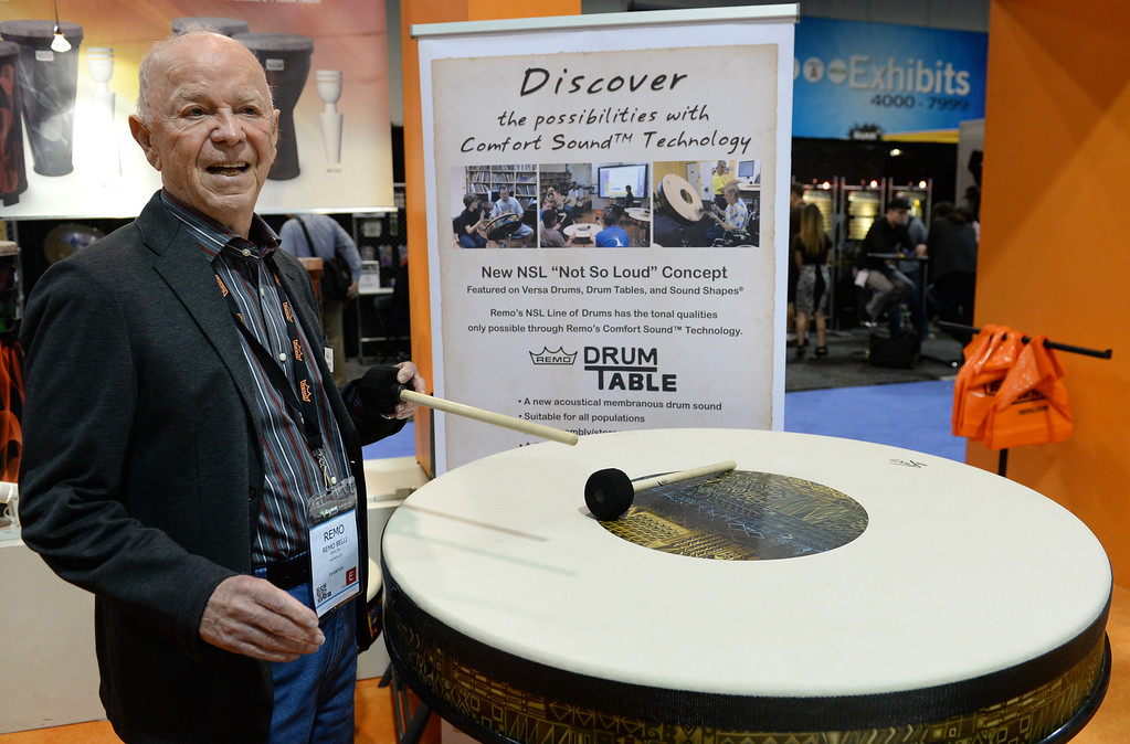 """. Remo Belli, owner of Remo drumheads and percussion instruments, shows their NSL \""""Not So Loud\"""" drum concepts designed for education and therapy during The NAMM (National Association of Music Merchants) Show, the world wide music trade show, at the Anaheim Convention Center in Anaheim on Friday January 24, 2014. NAMM is a music trade show drawing retailers and other industry people to Anaheim for four days of everything music. (Staff Photo by Keith Durflinger/San Gabriel Valley Tribune)"""