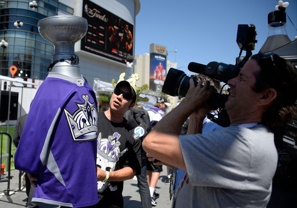 . June 13,2014. Los Angeles. CA. King fan Jesse Zaldivar shows his blowup stanley cup trophy, as thousands of LA King fans arrive hours early at Staples Center for game 5 of the Stanley Cup Playoffs. Photo by Gene Blevins/LA DailyNews