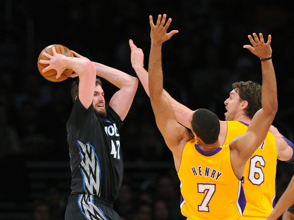 . The Timberwolves\' Kevin Love looks for help on the doubleteam by the Lakers\' Xavier Henry, left, and Pau Gasol in the first half, Friday, December 20, 2013, at Staples Center. (Photo by Michael Owen Baker/L.A. Daily News)