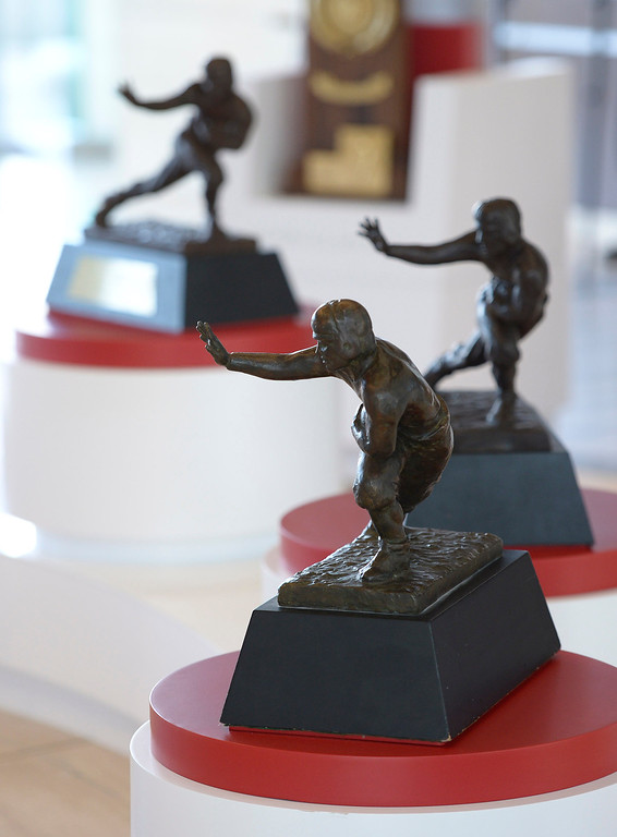 . All six Heisman Trophies are on display, and out in the open for students to touch. Heritage Hall, which houses USC\'s athletic department, has been closed for the past year while undergoing a $35-million renovation.  The building first opened in 1971 at a cost of $2.8 million and was originally 48,000 square feet. It now is 80,000 square feet. As part of the renovation, Heritage Hall\'s two-story lobby has been transformed into a state-of-the-art museum space featuring interactive displays. Heritage Hall also includes a sports performance center, a broadcast studio, a lounge for Women of Troy student-athletes, a rowing ergometer room and an indoor golf driving area, plus new locker rooms, meeting rooms, equipment room and event space.   Los Angeles , CA. January 30, 2014 (Photo by John McCoy / Los Angeles Daily News)