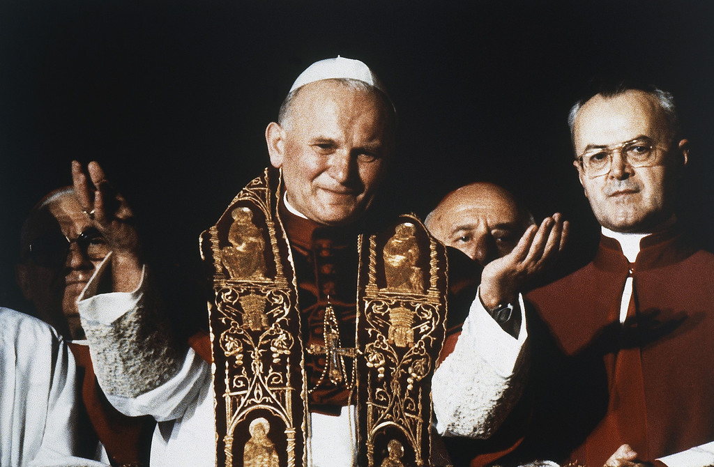 . Newly-elected Pope John Paul II, the former Polish Cardinal Karol Wojtyla, raises his arms to greet the crowd from the balcony of St. Peter\'s Basilica in Vatican City on Oct. 16, 1978. The new Pope was making his first public appearance, flanked by Virgilio Cardinal Noe, on the balcony overlooking the St. Peter\'s Square. (AP Photo/Massimo Sambucetti)