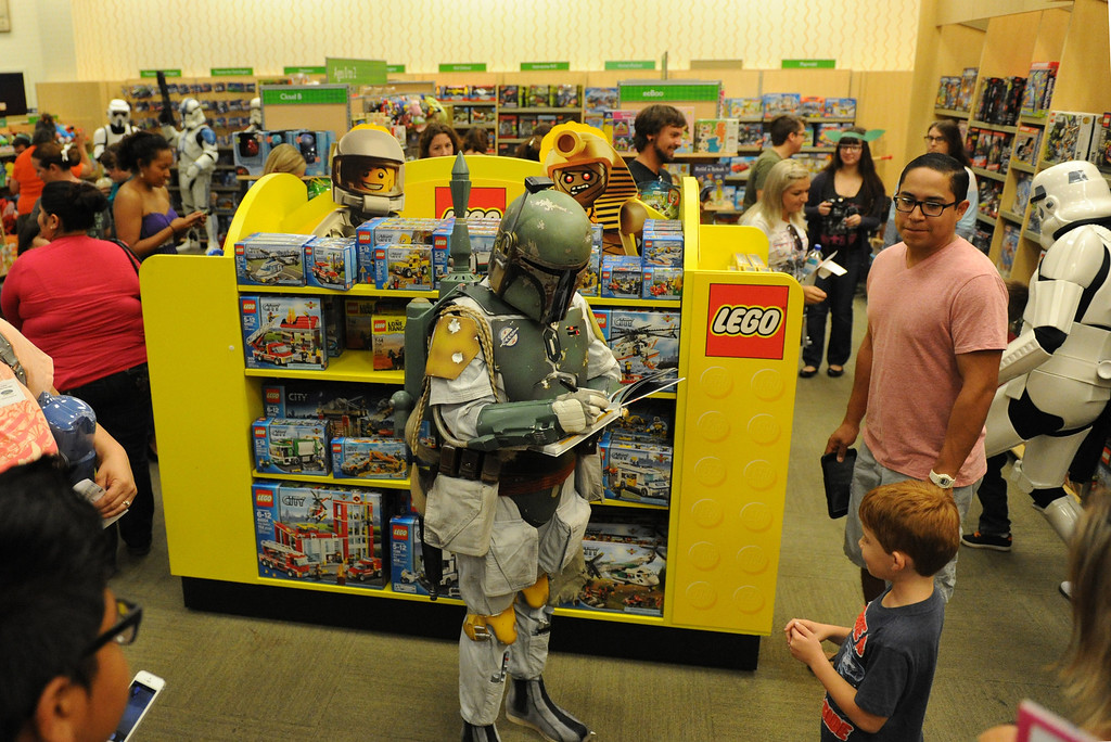 . (John Valenzuela/Staff Photographer)  Barnes & Noble Bookstore in Redlands hosted a Star Wars Reads Day on Saturday, Oct. 5, 2013. Members of 501st Stormtroopers were their posing for photos and signing autographs for Star Wars fans young and old.