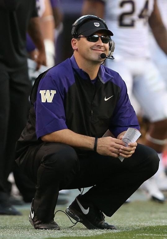 . Head coach Steve Sarkisian of the Washington Huskies watches from the sidelines during the college football game against the Arizona State Sun Devils at Sun Devil Stadium on October 19, 2013 in Tempe, Arizona.  The Sun Devils defeated the Huskies 53-24.  (Photo by Christian Petersen/Getty Images)