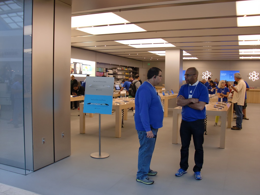 . Apple Store employees are on hand to manage the crowds waiting just outside the Westfield Topanga mall location at 9:30 a.m. Friday, Sept. 20, 2013, on the debut day for the new iPhone 5s and 5c. (Steven Rosenberg/Los Angeles Daily News)