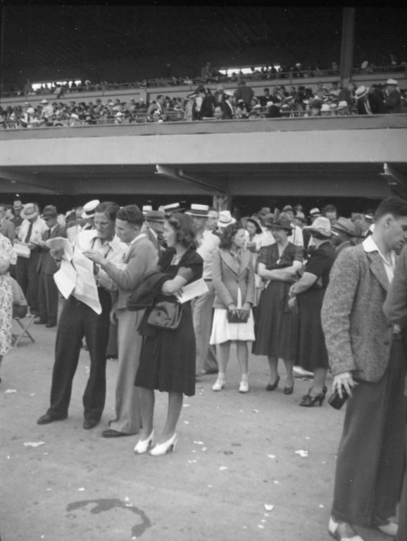 . Waiting for the next race at Hollywood Park in 1938.  (Los Angeles Public Library)