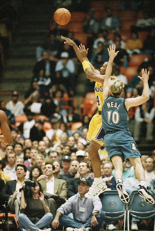 . Los Angeles Lakers Byron Scott, left, fires from the field over Minnesota Timberwolves Shane Heal during their game in Inglewood, Calif., on Sunday, Dec. 8, 1996. Scott was an integral part of three NBA championship teams with the Lakers during the 1980?s. He returned to the team this season because he believes it co-return to the top. (AP Photo/Reed Saxon)