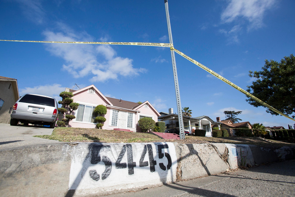 . Yellow police tape seals off the home of actor Michael Jace on Tuesday, May 20, 2014, in Los Angeles.  Actor Michael Jace was arrested on suspicion of murder in the shooting death of his wife, April, at their home in Hyde Park, police said. (AP Photo/Ringo H.W. Chiu)