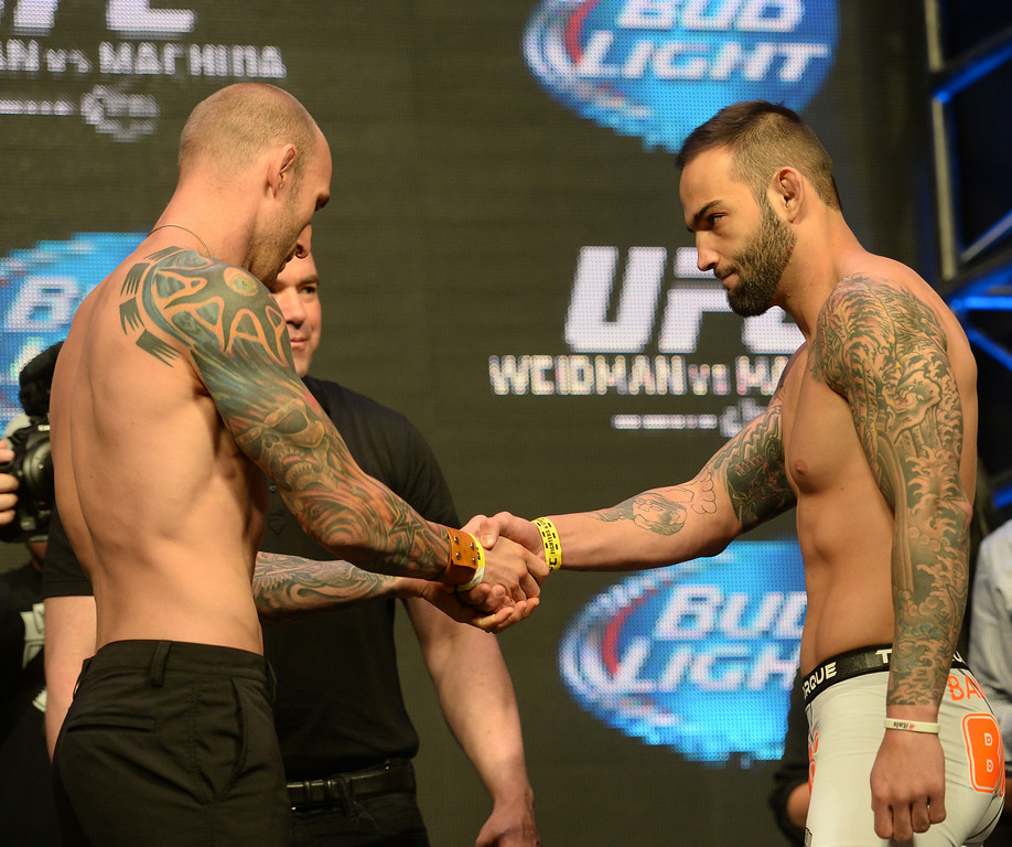 . Luke Zachrich and Guilherme Vasconcelos during weigh ins for UFC 175 at the Mandalay Bay Events Center July 4, 2014. (Photo by Hans Gutknecht/Los Angeles Daily News)