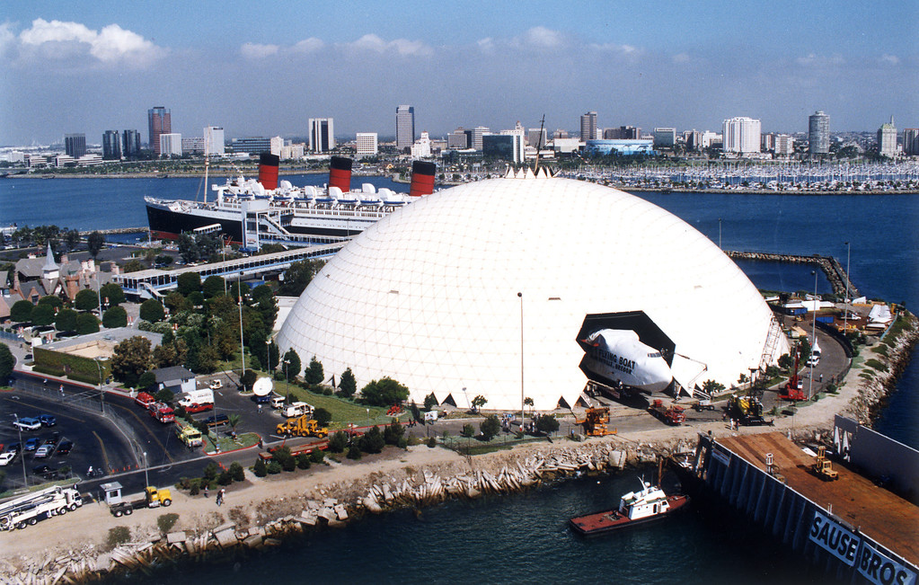 . Workers pull the Spruce Goose out of its dome which sits alongside the Queen Mary in Long Beach.   (10/1/92) Los Angeles Daily News file photo