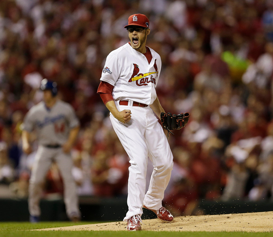 . St. Louis Cardinals starting pitcher Joe Kelly reacts after getting Los Angeles Dodgers\' Yasiel Puig to strike out during the first inning of Game 1 of the National League baseball championship series Friday, Oct. 11, 2013, in St. Louis. (AP Photo/Jeff Roberson)
