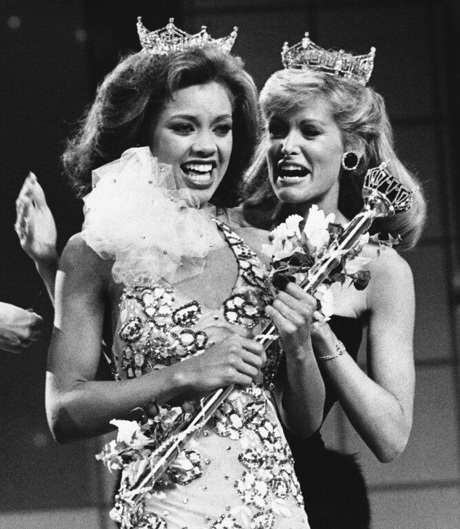 . Vanessa Williams, the new Miss America, left, is shown as she is crowned, Saturday, Sept. 17, 1983 in Atlantic City, New Jersey, by the outgoing Miss America, Debra Maffett. (AP Photo)