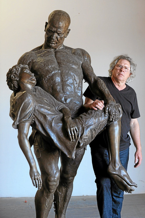 . Glassel Park sculptor Christopher Slatoff poses with The Illustrated Man sculpture September 4, 2013.(Andy Holzman/Los Angeles Daily News)