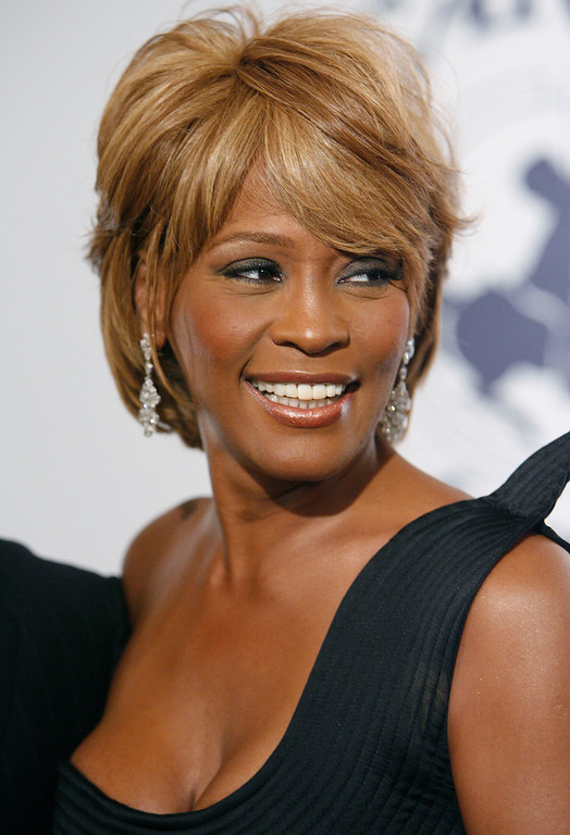 . In this Oct. 28, 2006, file photo, musician Whitney Houston arrives at the 17th Carousel of Hope Ball benefiting the Barbara Davis Center for Childhood Diabetes in Beverly Hills, Calif. Houston died Saturday, Feb. 11, 2012, she was 48. (AP Photo/Matt Sayles)