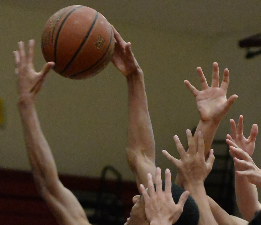 . West Covina\'s Darrion Chavers, left, fights for the rebound against Diamond Ranch in the first half of a prep basketball game at West Covina High School in West Covina, Calif., on Wednesday, Jan. 8, 2014. (Keith Birmingham Pasadena Star-News)