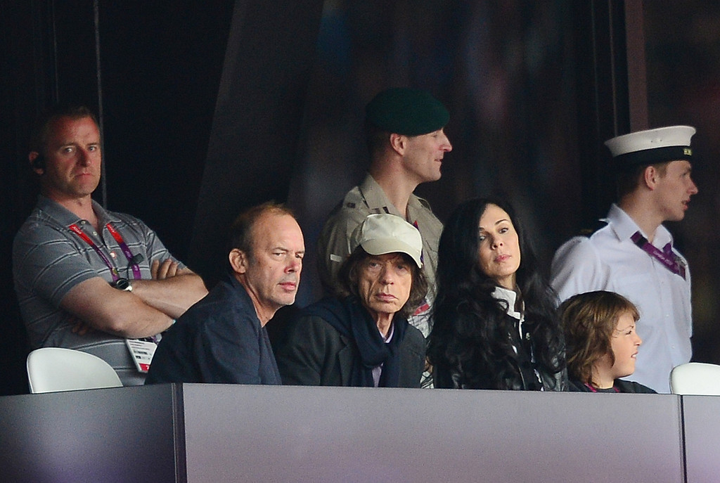 . Mick Jagger (C), his son Lucas (R) and his partner US fashion designer L\'Wren Scott (2R) attend the athletics event of the London 2012 Olympic Games on August 6, 2012 in London.            (GABRIEL BOUYS/AFP/GettyImages)