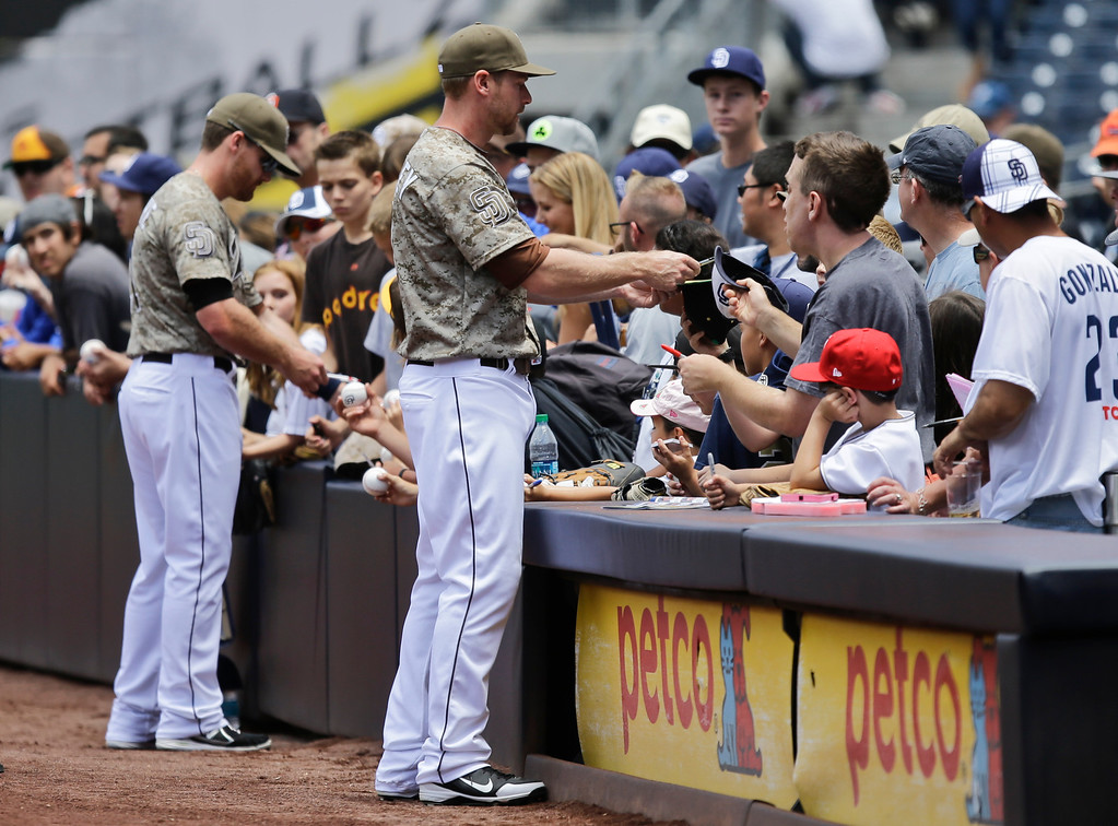 . San Diego Padres\' Chase Headley, right, and Logan Forsythe sign autographs before a baseball game against the Los Angeles Dodgers in San Diego, Sunday, June 23, 2013. (AP Photo/Lenny Ignelzi)