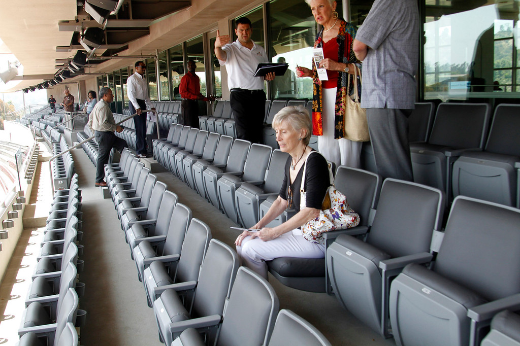 . Guests sit in the Club Seats during  a tour of the newly renovated Pavilion at the Rose Bowl in Pasadena, Saturday, June 8, 2013. The new $84 million Pavilion completed this spring after more then two years of construction, contains premium seating section, press box, sound system and stadium security operations. (Correspondent Photo by James Carbone/SXCITY)