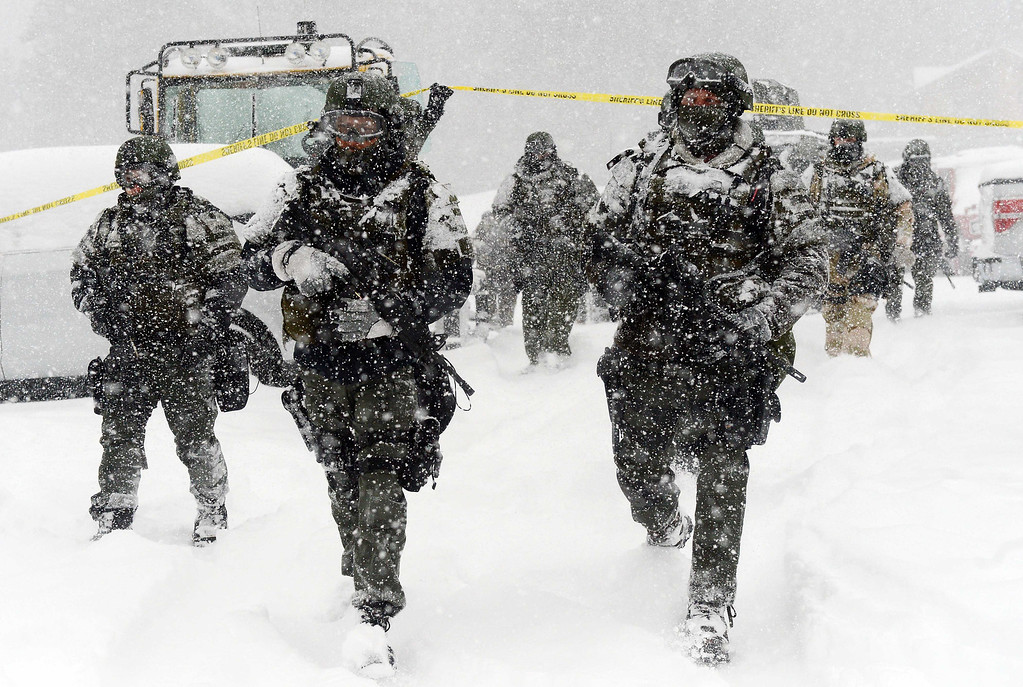 . A San Bernardino County Sheriff SWAT team returns to the command post at Bear Mountain in Big Bear after searching for Christopher Jordan Dorner Friday February 8, 2013. Search conditions have been hampered as a heavy winter storm has hit the area. (Staff photo by Will Lester/Inland Valley Daily Bulletin)